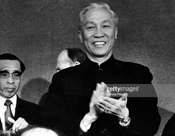 The North Vietnamese delegate Le Duc Tho pseudonym of Phan Dinh Khai applauds in Paris during a press conference which he held following the...