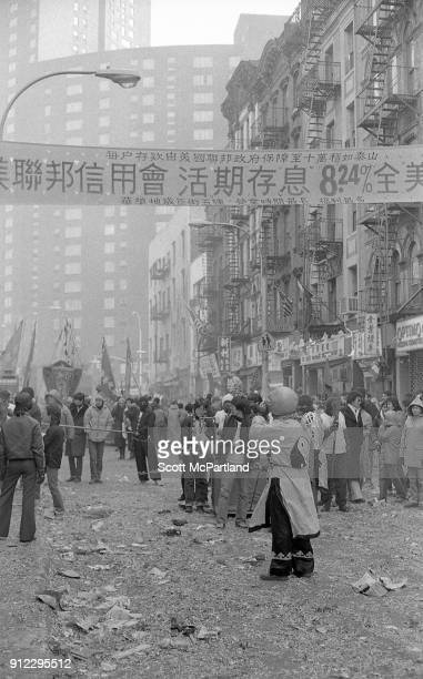 The streets of Chinatown New York are littered with spent firecrackers as large crowds gather to celebrate the Lunar New Year
