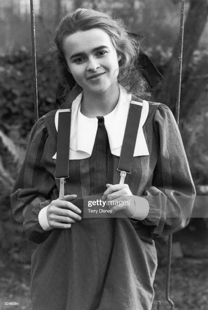 English actress Helena Bonham Carter wearing baggy dungarees and a blouse with a wide collar.