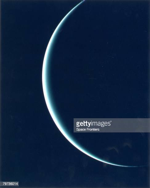 The crescent of Uranus as recorded by Voyager 2, on its way to Neptune. The pale blue-green color results from the presence of methane in the...