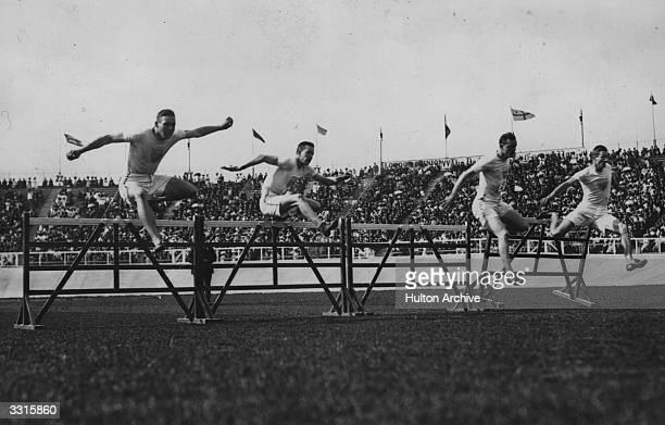 Forrest Smithson of the USA on his way to winning the 110meter hurdles final at the 1908 London Olympics