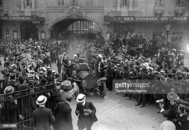 Crowds cheer French aviation pioneer Louis Bleriot at Victoria station London after his historic Channel flight Seated next to Bleriot is the 1st...