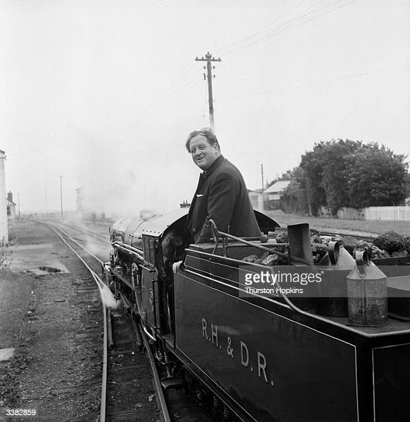 Broadcaster and journalist Richard Dimbleby driving a steam engine on the 15 inch gauge ROmney Hythe Dymchurch Railway during the making of the BBC...