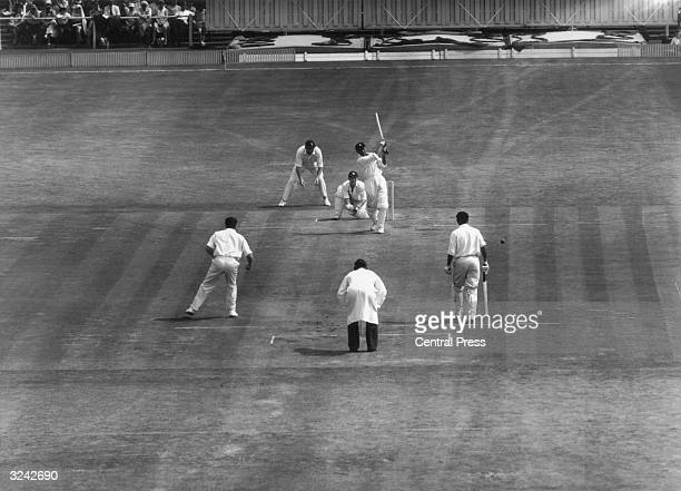Indian batsman Chandrakant Gulabrao Borde striking a ball from Ken Barrington during India's first innings on the third day of the Fourth Test at Old...