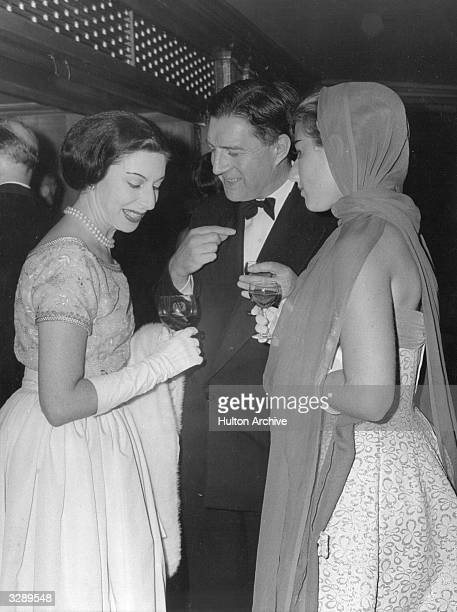From left to right, English ballerina Alicia Markova chats with George B Wilson and Anne Constant at a reception in the Dorchester Hotel.