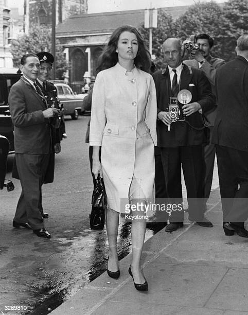 Christine Keeler key witness in the vice case against society osteopath Stephen War on her way to the Old Bailey with photographers ready to catch her