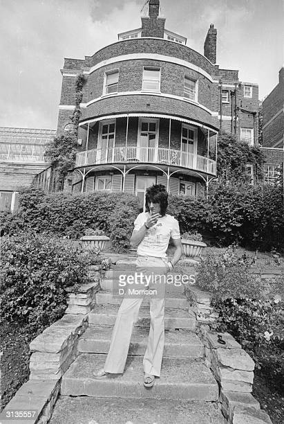 Ron Wood, a guitarist with the Rolling Stones amongst other groups, in the garden of his London studio and home, the Wick.