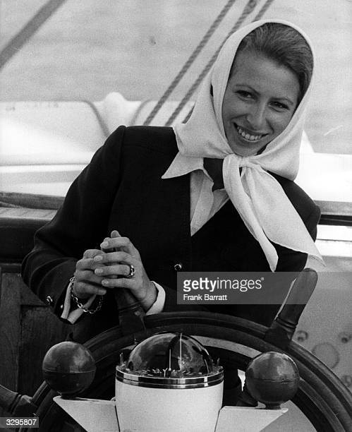 Princess Anne Elizabeth Alice Louise at the helm of a yacht