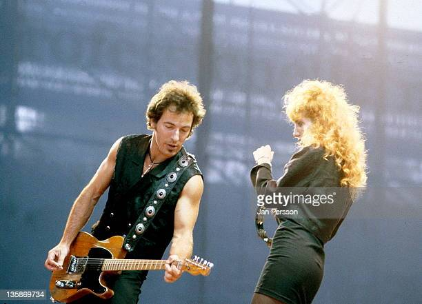 25th JULY: Bruce Springsteen performs live on stage with his wife Patti Scialfa at Idraetsparken in Copenhagen, Denmark during the Tunnel Of Love...