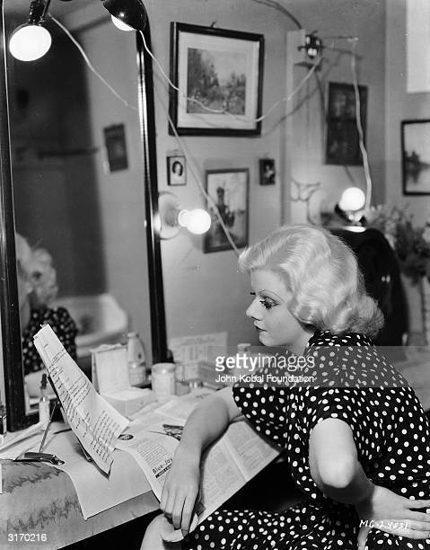 Blonde bombshell MGM star Jean Harlow studying a script in her dressing room