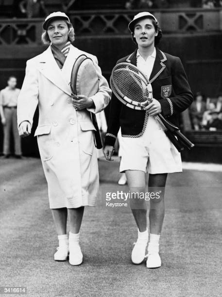 American tennis player Alice Marble walking on to court at Wimbledon with Britain's Kay Stammers