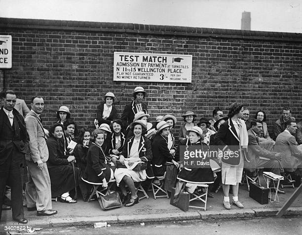 Hampstead schoolgirls in an early morning queue to get into Lord's cricket ground London to see the second Test between England and Australia
