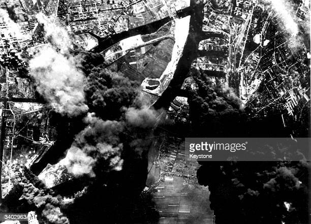 The Olwerne Schindler Ernest Schliemann Deutsche Petroleum and Harburg refineries in Hamburg burning after a bomb attack by the US Eighth AAF...