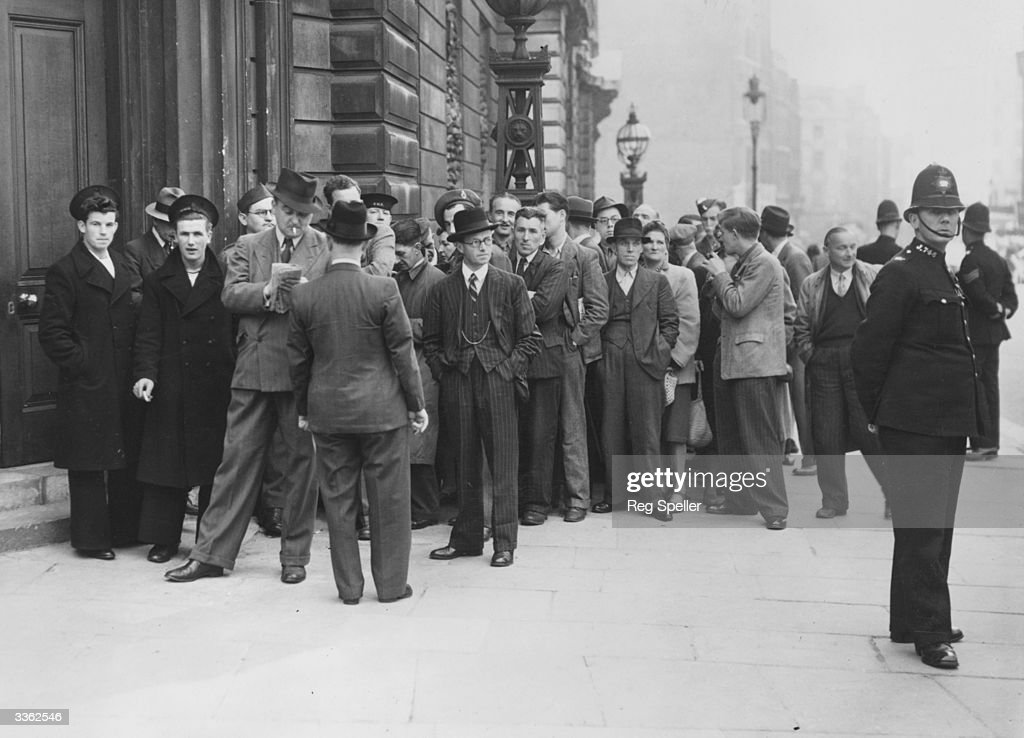 A crowd gathered at Bow Street for the trial of Lord Haw-Haw (William Joyce) the infamous English criminal convicted and hung as a traitor for passing secrets to the Germans during World War II.