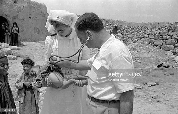 A young Palestinian refugee receiving attention from the Red Cross stationed near the shores of the Dead Sea in Jordan in the year following the Arab...