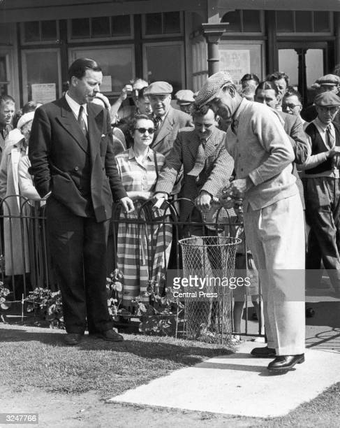 American golfer Ben Hogan unwraps the British ball before the British Open Golf Championship at Carnoustie