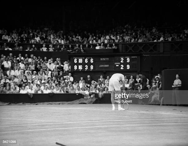 American tennis player Budge Patty suffering from cramp during the fifth set of his match against Jaroslav Drobny at Wimbledon