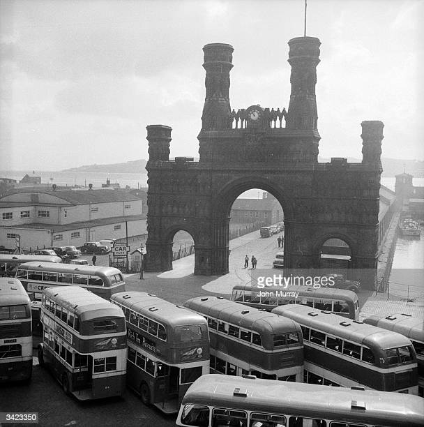 Buses cluster beside the Royal Arch on Shore Terrace which dominates Dundee's dockland area Dundee situated on the banks of the dSilvery Tayf is...