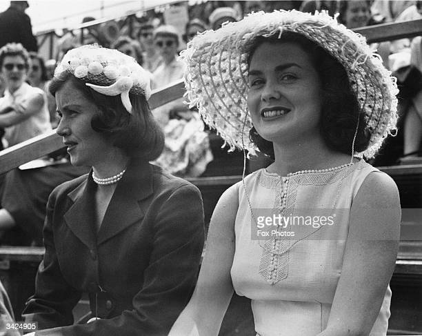 Dolly Seixas wife of American tennis player Vic Seixas watching her husband in action against Mal Fox at the Wimbledon Lawn Tennis Championships She...