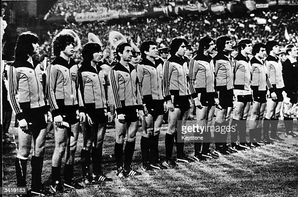 The players of the Argentine national football team line up before the kickoff of the World Cup final at the River Plate Stadium in Buenos Aires...