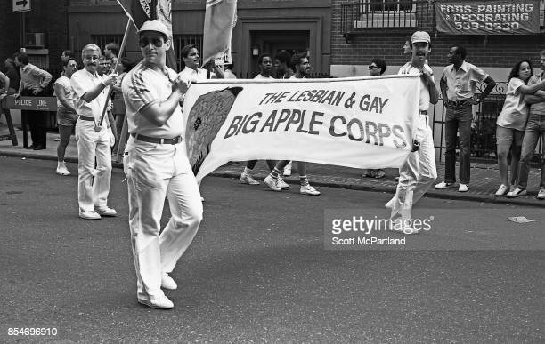 Activists from the Lesbian and Gay Big Apple Corps march down Waverly Place in Greenwich Village Manhattan during the 1983 Gay Pride Parade