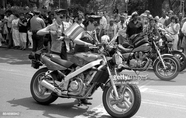 Activists from the LGBTQ community prepare to ride their motorcycles at the start of the Gay Pride Parade commemorating the 20th anniversary of the...