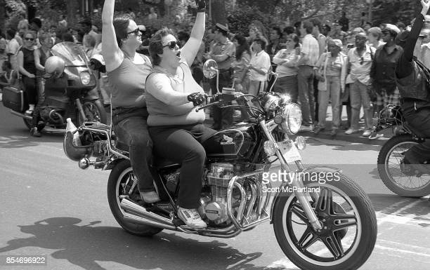 Activists from the LGBTQ community ride their motorcycles with fists in the air at the start of the Gay Pride Parade commemorating the 20th...