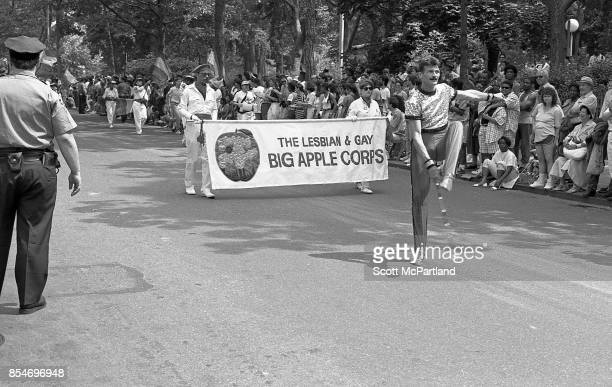 Crowds of onlookers line Washington Square Park as activists from the Gay and Lesbian Big Apple Corps march with their batons down the street at the...