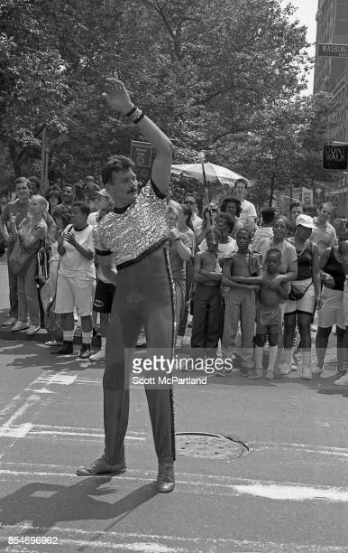 Crowds of smiling onlookers line Washington Square Park as an activist from the Gay and Lesbian Big Apple Corps dances in the middle of the street at...