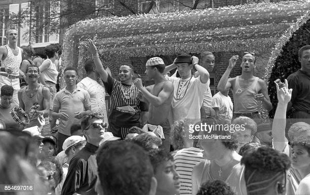 Gay rights activists smile and wave to the crowd from a parade float during the 1989 Gay Pride Parade in Greenwich Village Manhattan commemorating...