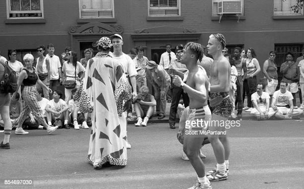 Parade participants dance in the street in front of onlookers at the 1989 Gay Pride Parade in Greenwich Village Manhattan