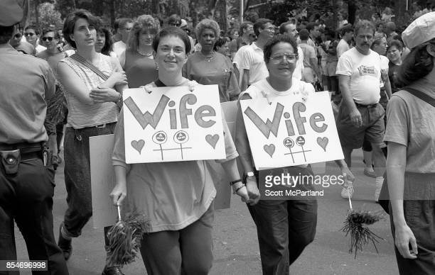 Two women wearing 'Wife' signs around their necks smile for the camera at the 1989 Gay Pride Parade in Greenwich Village Manhattan commemorating the...