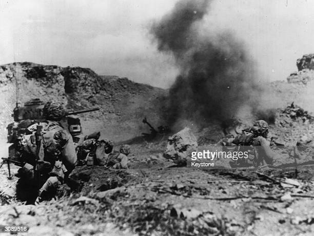 American Marine Corp rocketeers attack Japanese positions in Iwo Jima in support of a leatherneck advance