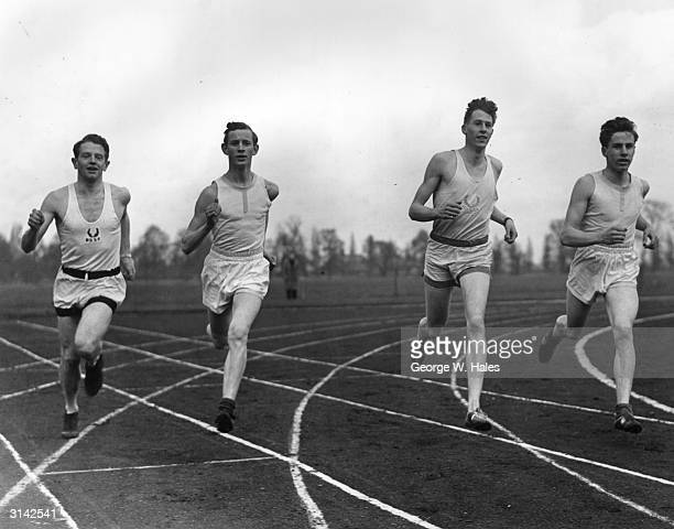 British athletes Chris Chataway and Roger Bannister during a warmup lap before an athletics match