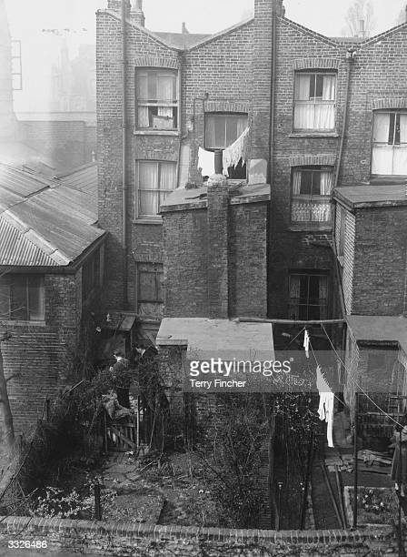 Police searching the back garden of 10 Rillington Place in Notting Hill London home of John Christie where the bodies of three women were found and a...