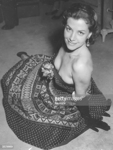 Brazilian actress Vera Clouzot wearing a handbeaded short silk evening dress designed by Christian Dior