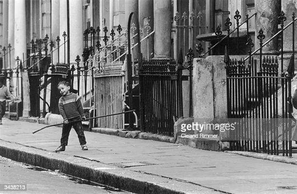 Child playing in a street in Notting Hill, west London.