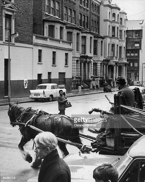 Rag-and-bone man driving his cart along a street in Notting Hill, west London.