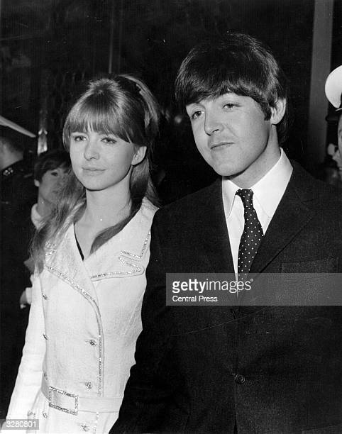Paul McCartney singer and bass player with The Beatles arrives with his girlfriend actress Jane Asher at the premiere of Michael Caine's new film...