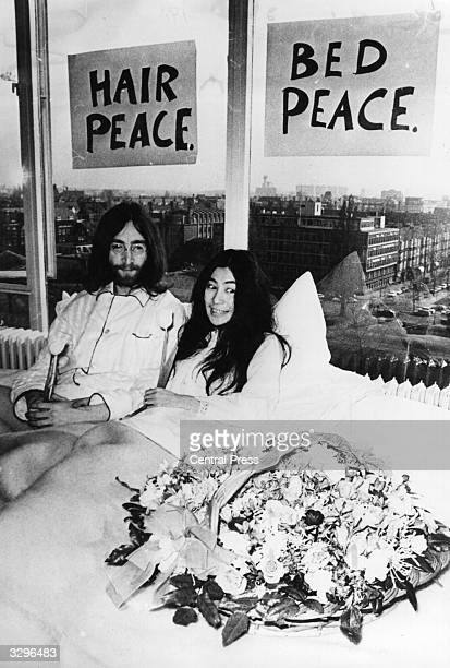 John Lennon singer songwriter and guitarist with the Beatles in bed in the Presidential Suite of the Hilton Hotel in Amsterdam with his wife artist...