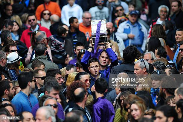 A man holding up his drum over the crowd during the Holy Week celebrations in Calanda Spain 25th of March 2016