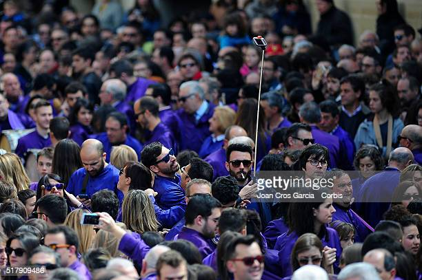 A man taking a selfie during the Holy Week celebrations in Calanda Spain 25th of March 2016