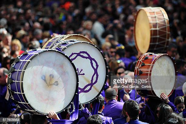 People holding up their drums over the crowd during the Holy Week celebrations in Calanda Spain 25th of March 2016