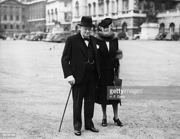 Winston Churchill and his wife Clementine on their way to No 10 Downing Street where they are to take up their official residence on his becoming...