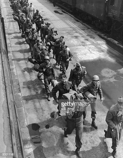 Highangle image of American soldiers marching along a bridge towards the docks of Le Havre to board homeward bound ships France World War II
