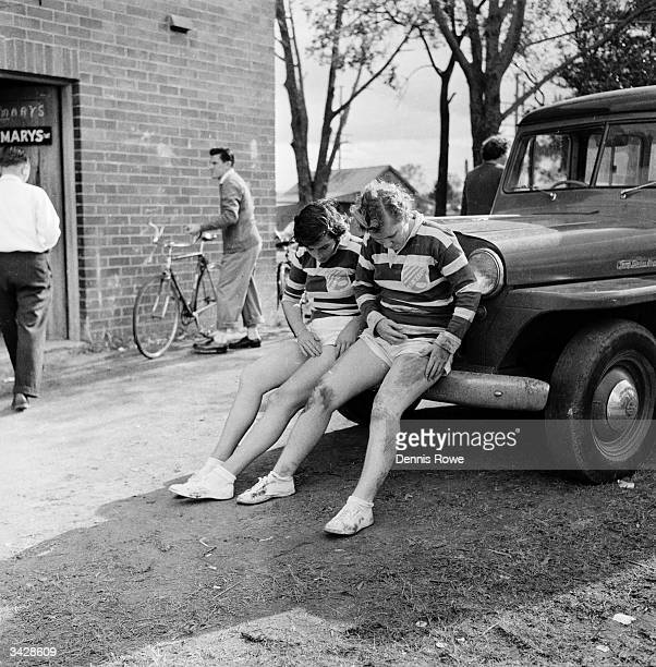 Two female rugby players from the town of St Mary's in New South Wales examine their bruises after a successful match against the neighbouring town...