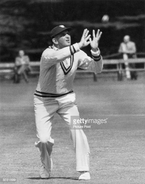 CHECK HIRES IF SUPPLYING DIGITALLY England and Gloucester batsman Tom Graveney taking a catch for Gloucester against Oxford University PP 8920 Vol 75...