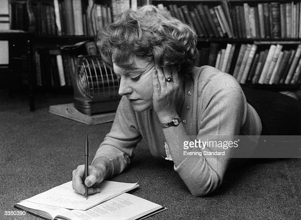 Scottishborn novelist Muriel Spark makes notes while lying on the floor Muriel Spark was born in Edinburgh and began writing in the 1960's Her first...