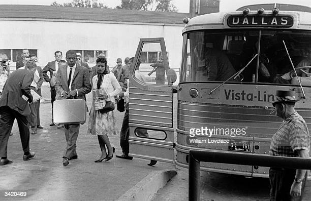 Group of Black Americans get off the 'Freedom Bus' at Jackson, Mississippi, to protest against the segregation of passengers on the nation's buses.