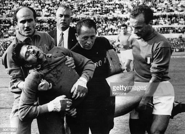 Lorenzo Buffon goalkeeper for Italy is carried off the field with a broken nose after diving to save a goal in the 55th minute The game held at the...